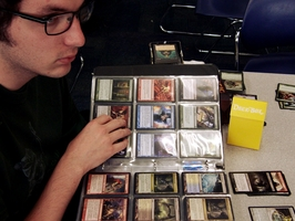 Take a look at Magic The Gathering Deck Builder 31